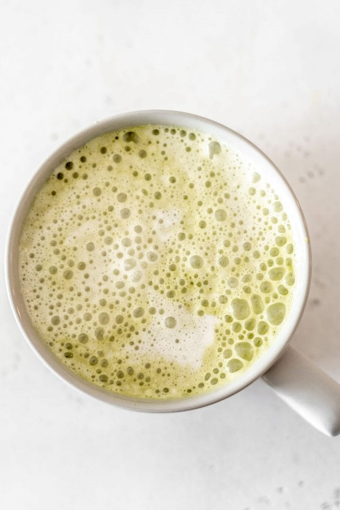 Homemade hemp milk matcha latte in a grey mug.