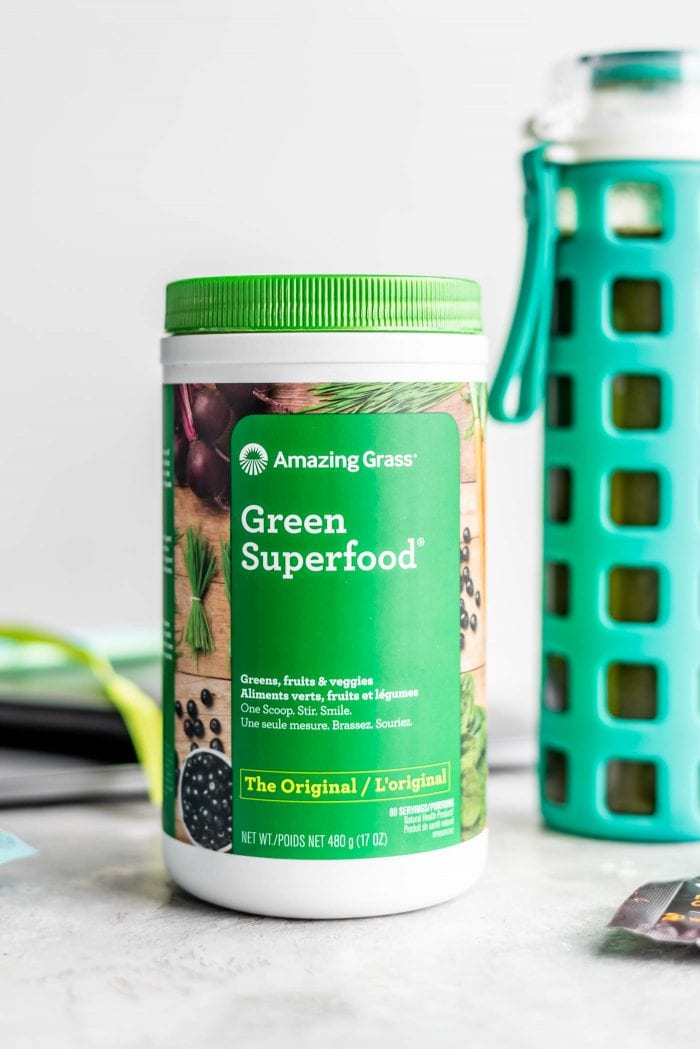 A container of Amazing Grass Green Superfood powder.