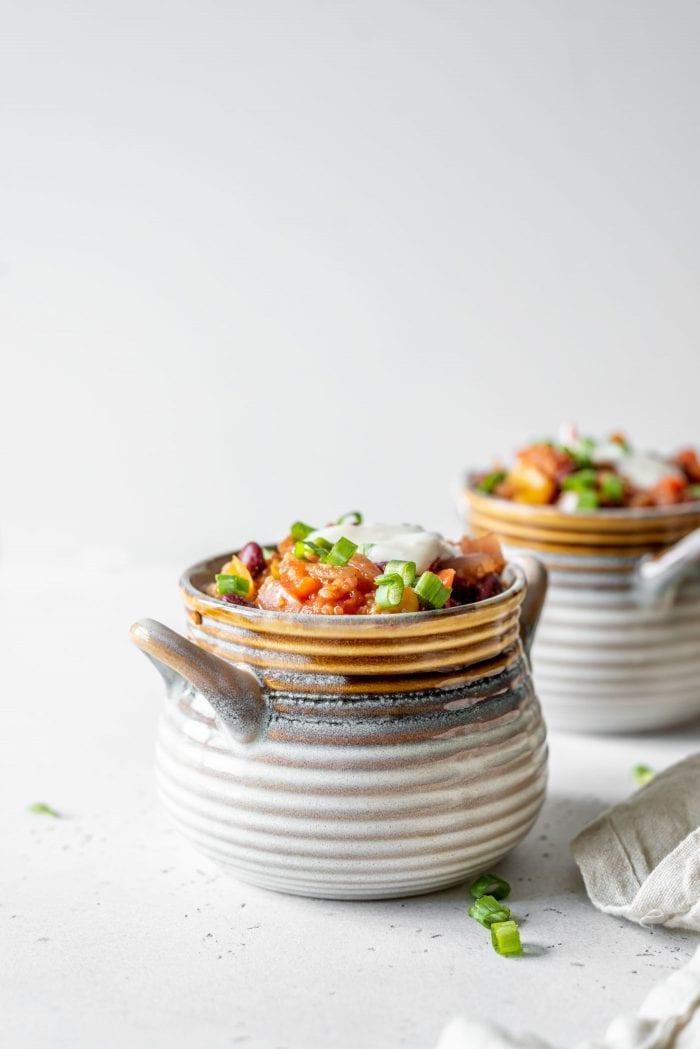 Two bowls of vegan quinoa chili.