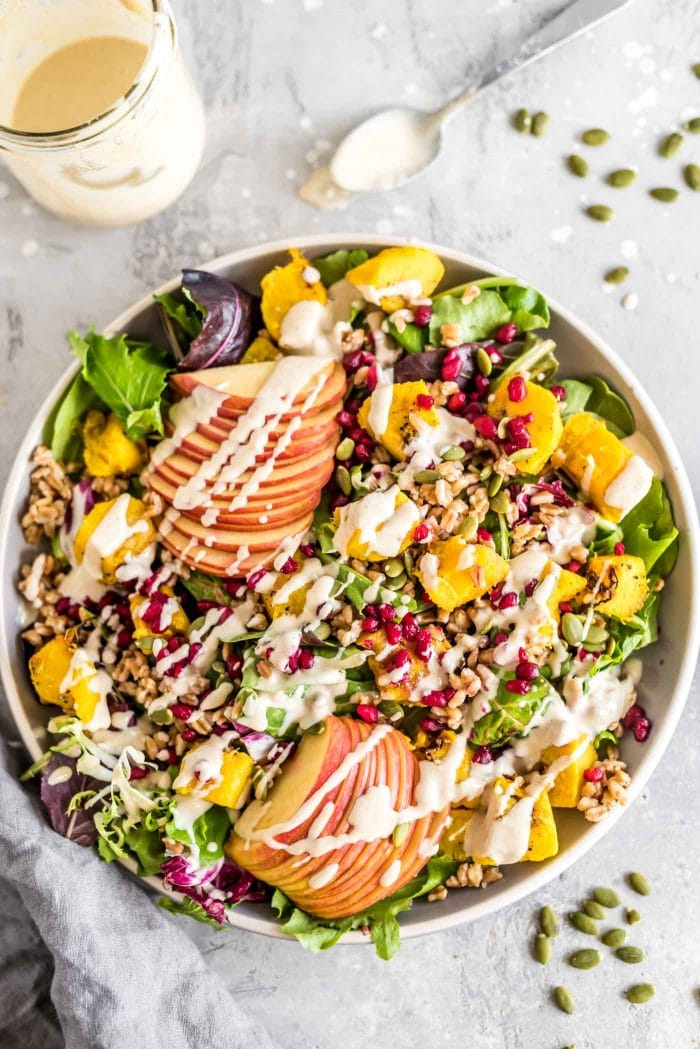 Very colourful and beautiful farro salad topped with tahini dressing.