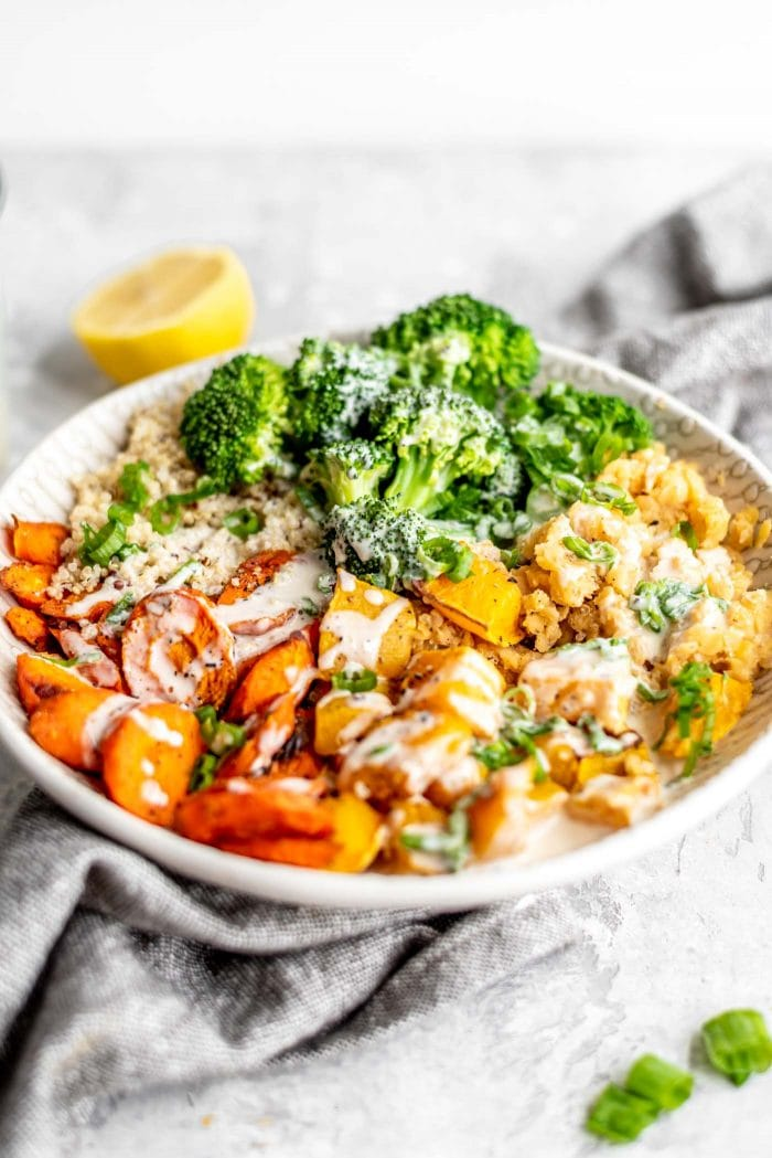 Buddha bowl with lentils, quinoa, broccoli, squash and carrots.