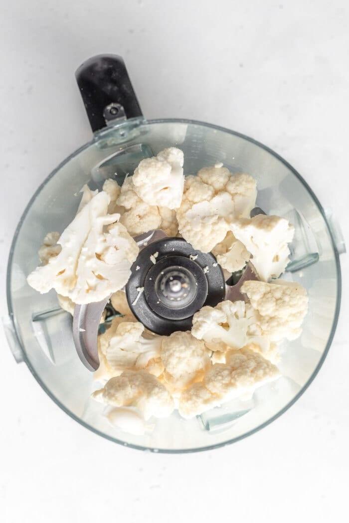 Chopped cauliflower in a food processor.