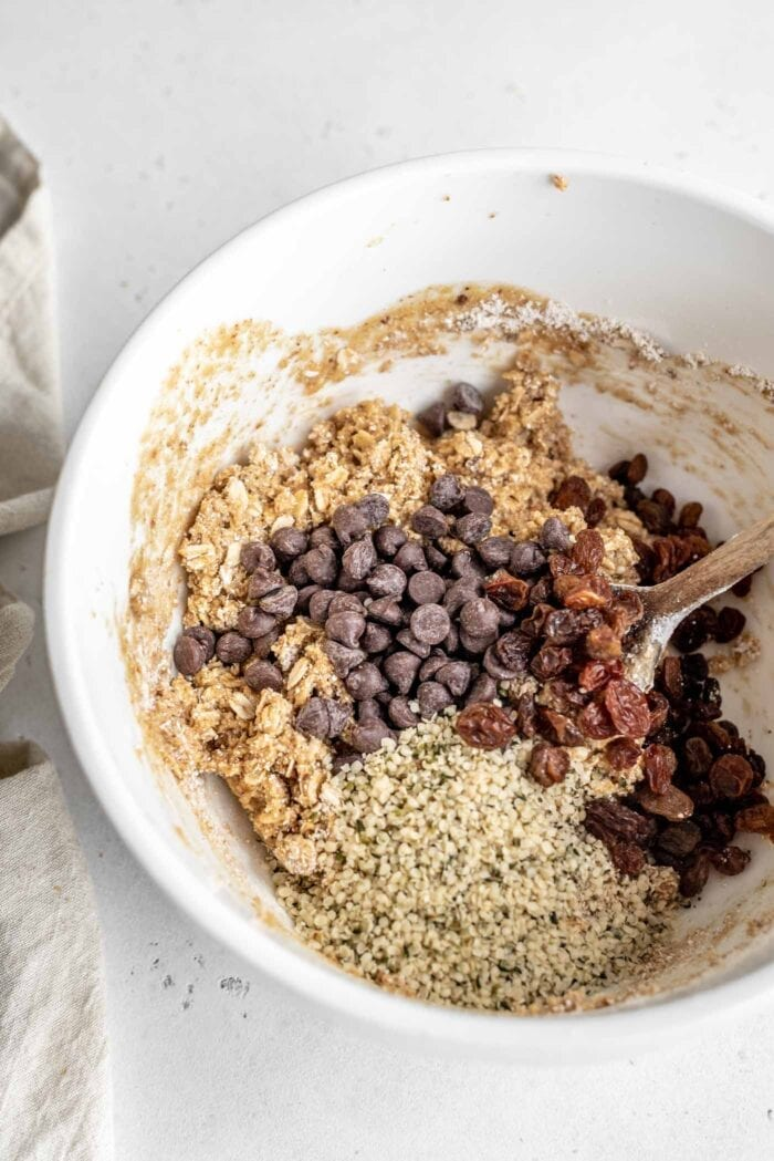 Bowl of cookie dough with chocolate chips, raisins and hemp seeds added.