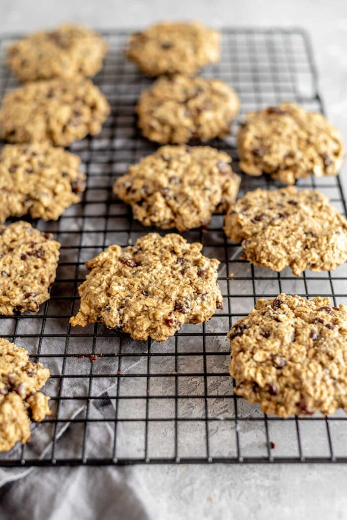 Healthy oat cookies sitting on a cooling rack.