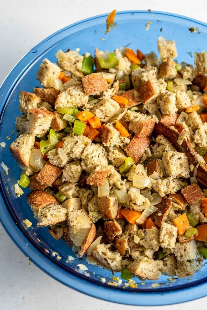 Mixed vegan stuffing in a big blue glass bowl.