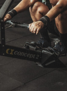 Man on a Concept 2 rowing machine.