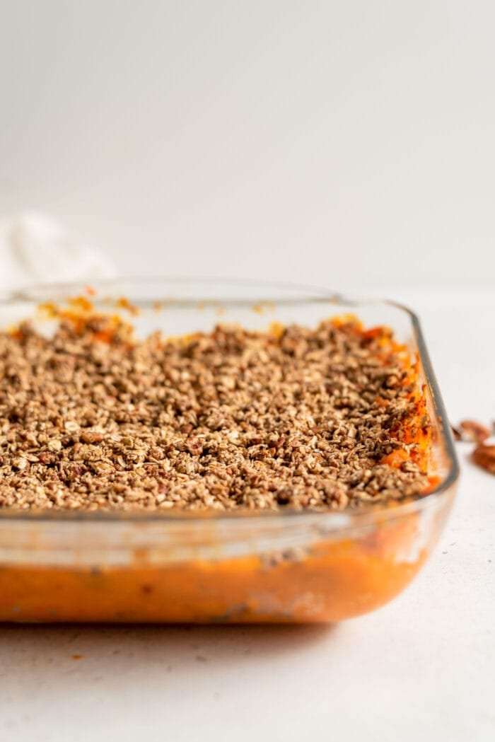 Pecan and oat sweet potato casserole in a baking dish.