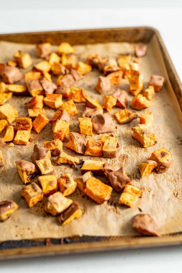 Roasted sweet potato on a baking tray.
