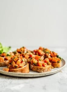 Pieces of vegan bruschetta on a plate.