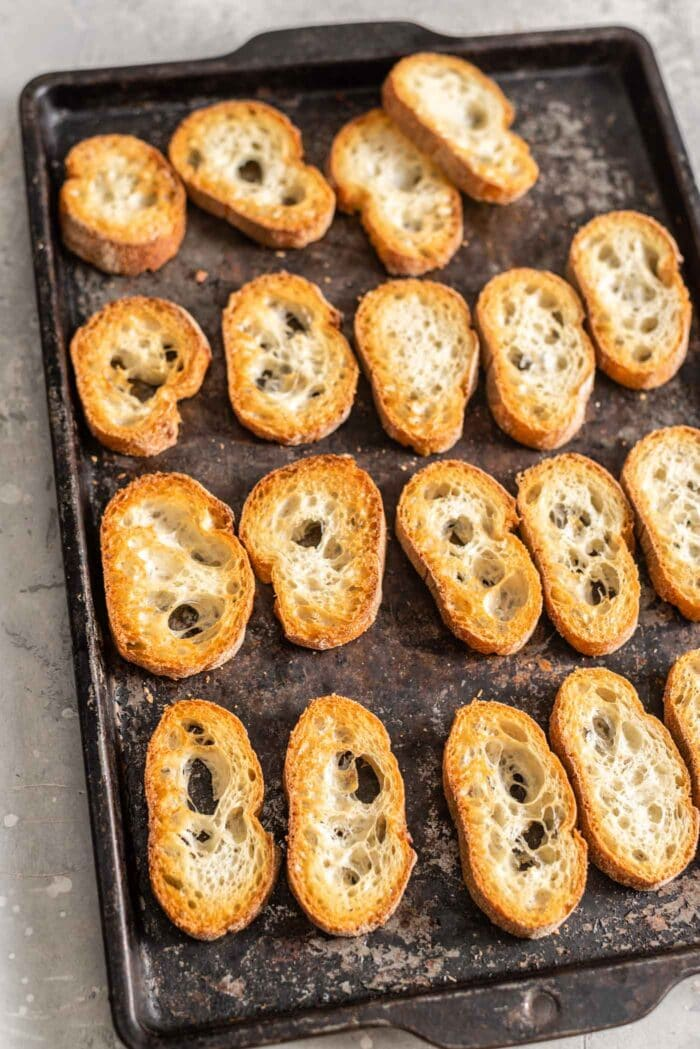 Toasted baguette on a baking tray.