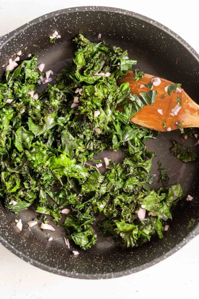 Sauteed kale in a skillet.