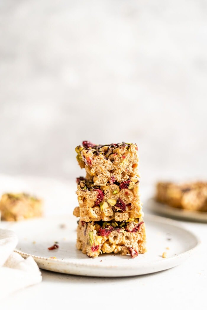 A stack of 3 Christmas vegan cereal bars on a small plate.