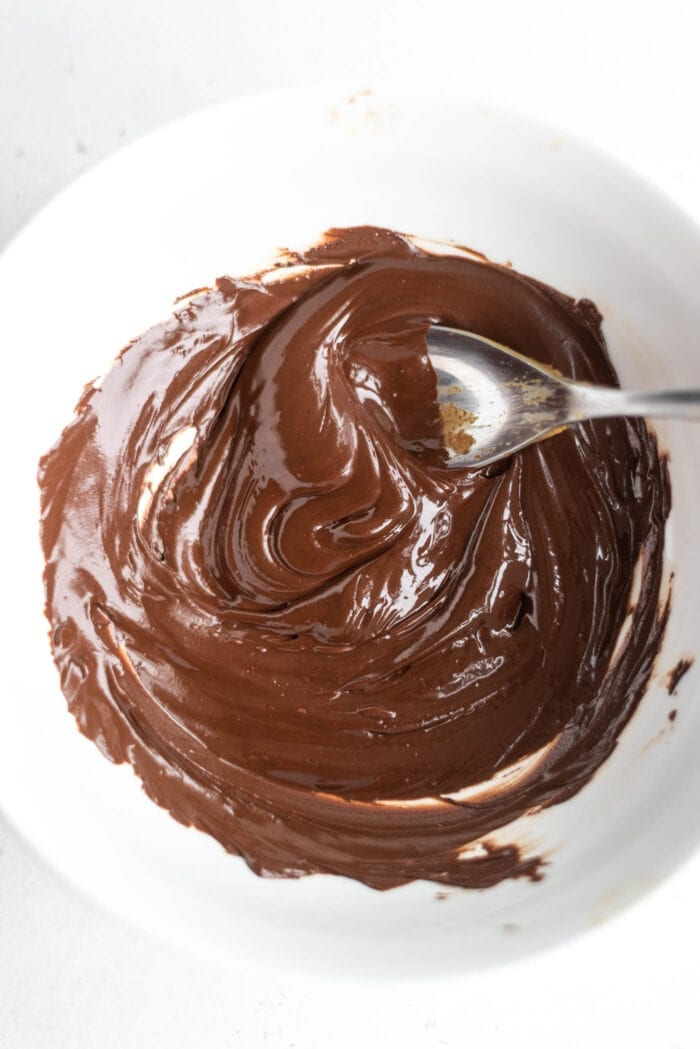 Melted chocolate in a white bowl.