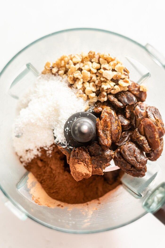 Dates, coconut, walnuts and cocoa powder in a food processor.