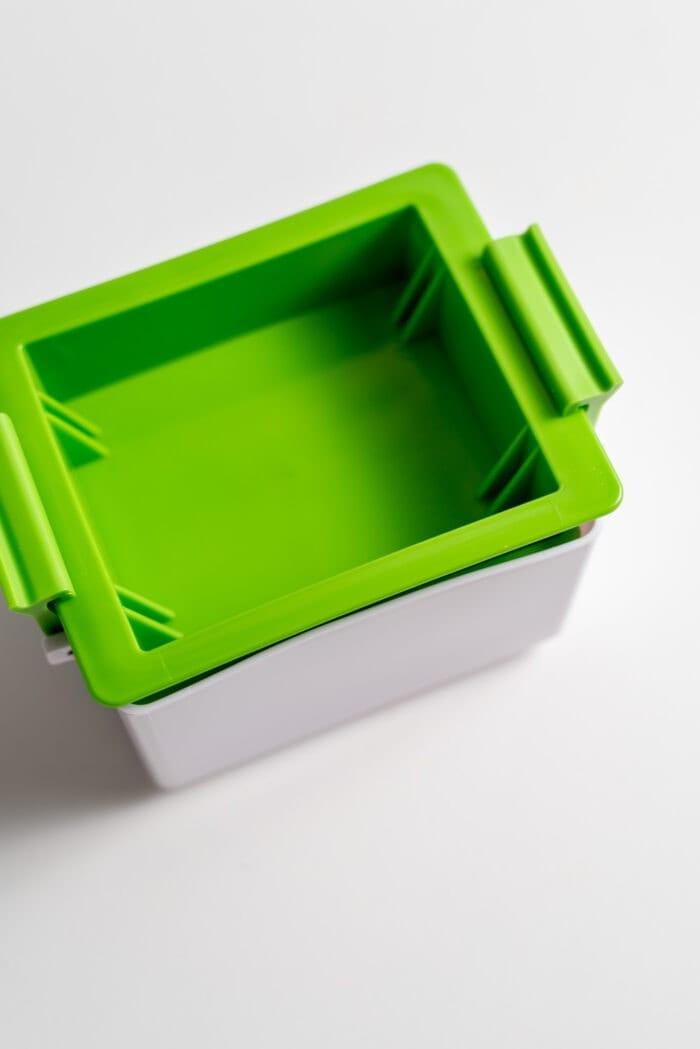 A sealed green tofu press.