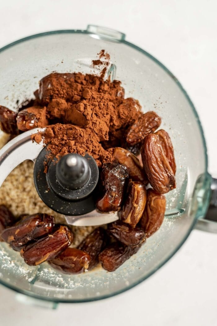 Dates, cocoa, coconut and walnuts in a food processor.