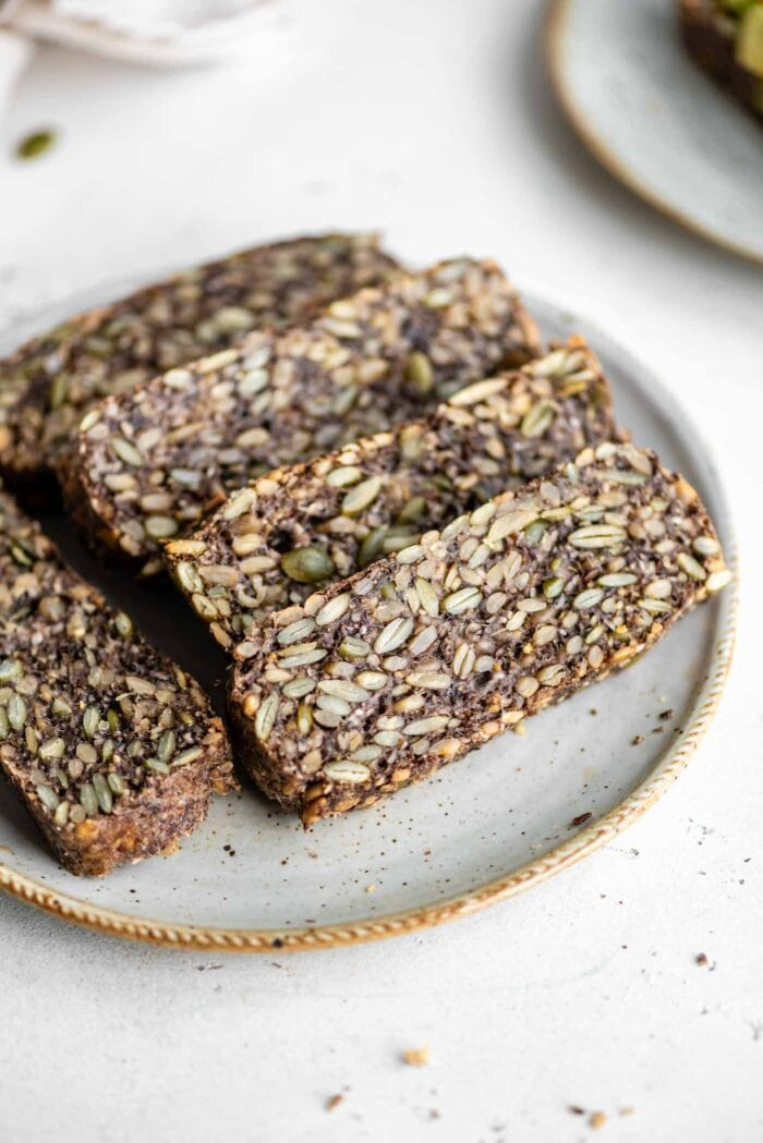 Slices of seed bread on a plate.