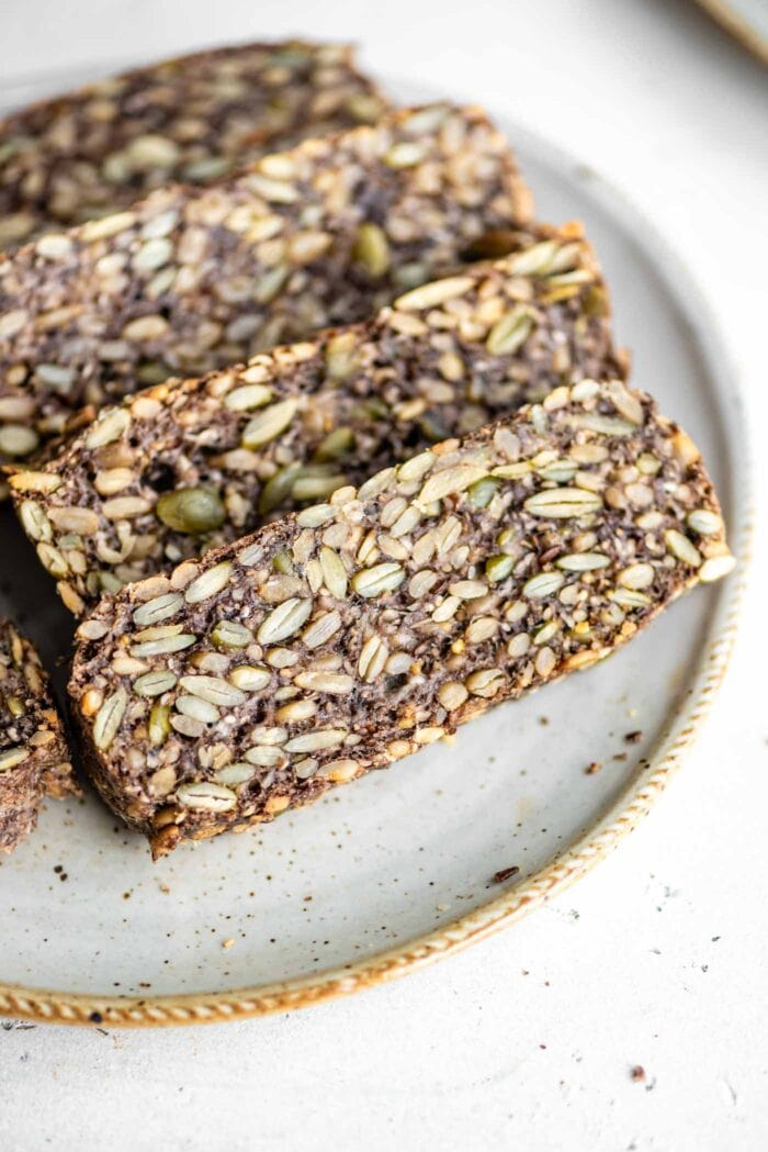 Slices of hearty seed loaf on a plate.