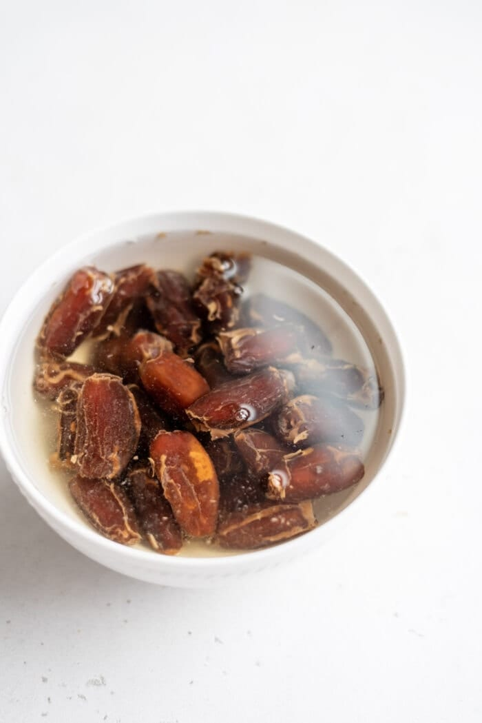 Dates soaking in a bowl of water.