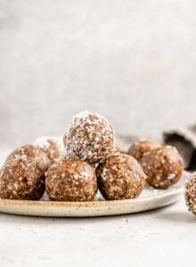 A stack of raw energy balls on a plate.