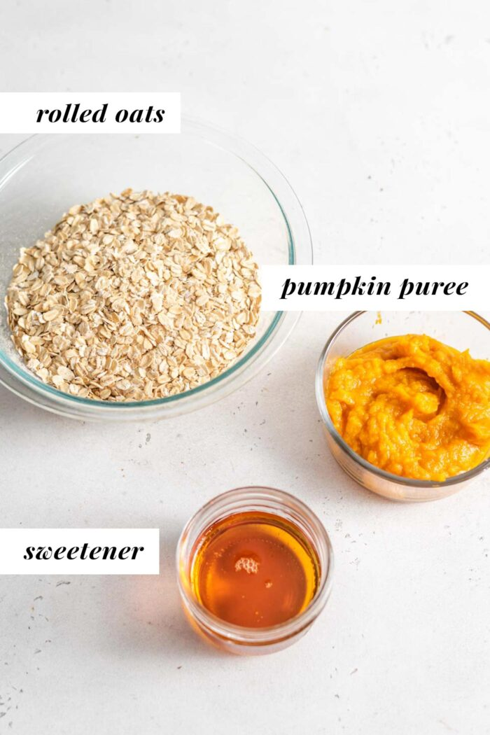 Pumpkin, oats and maple syrup in containers.