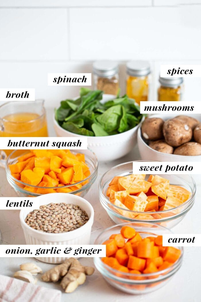 Labelled ingredients for a squash, carrot and lentil stew on a counter top.