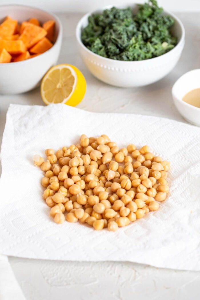 Cooked chickpeas sitting on paper towel.