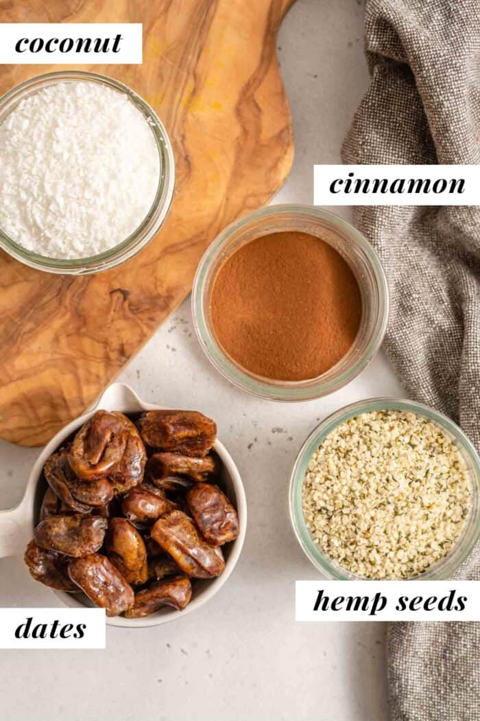 Dates, hemp seeds, cinnamon and coconut in jars.