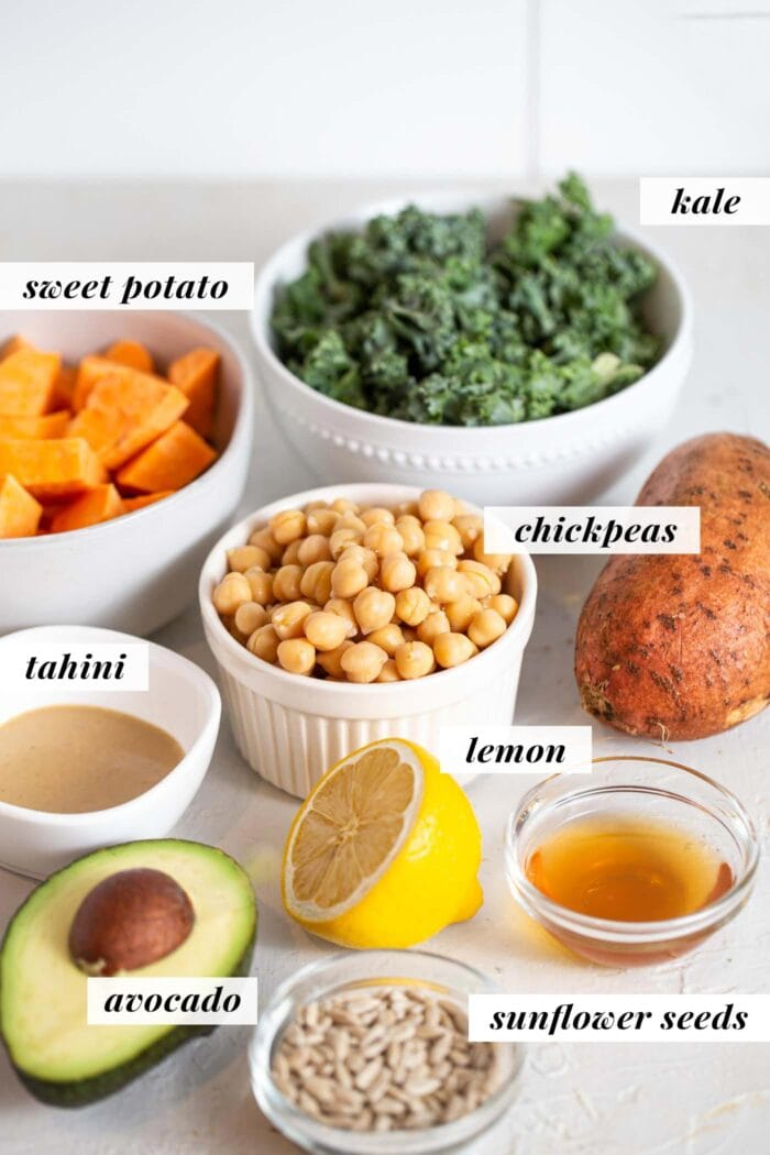 Labelled ingredients for a roasted sweet potato and chickpea kale salad.