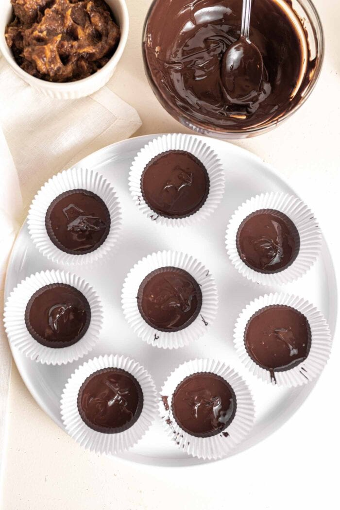 Melted chocolate in the bottom of 12 muffin liners.