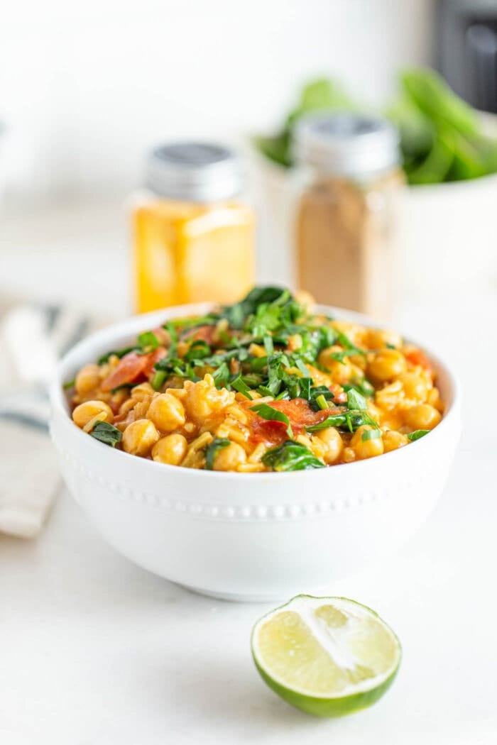 A bowl of chickpea rice stew topped with fresh cilantro.