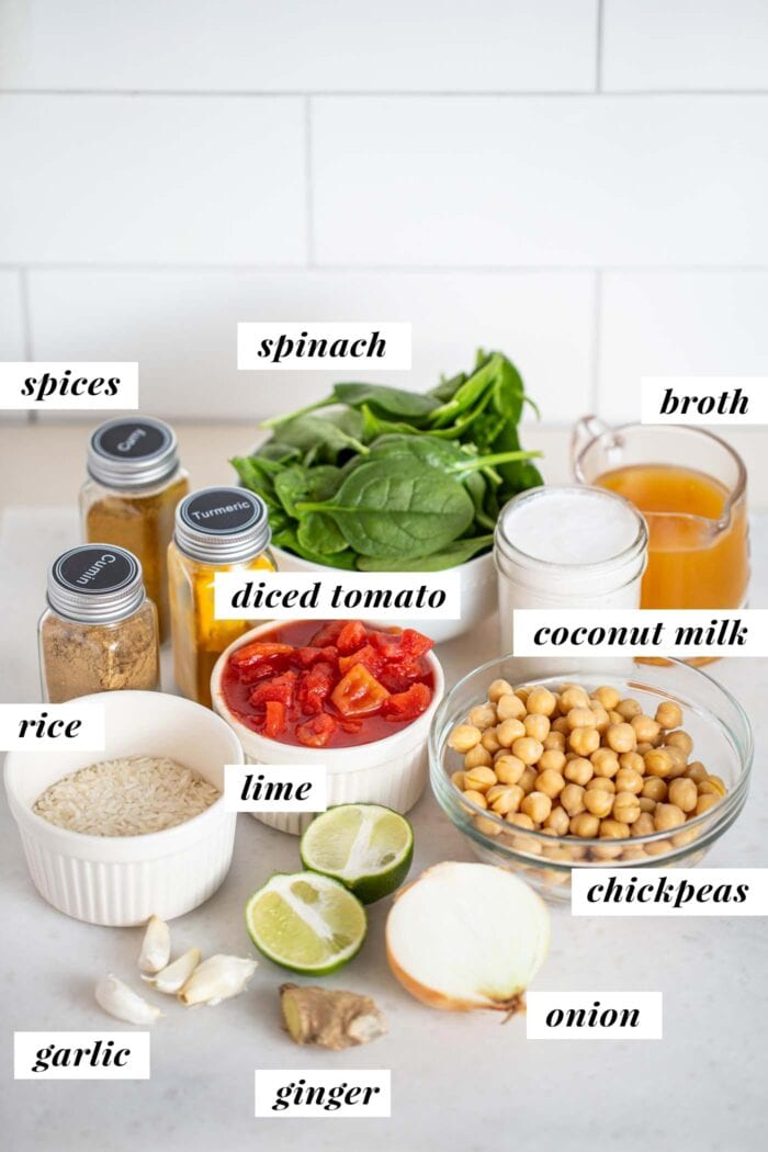 Labelled ingredients for a tomato rice and chickpea stew.