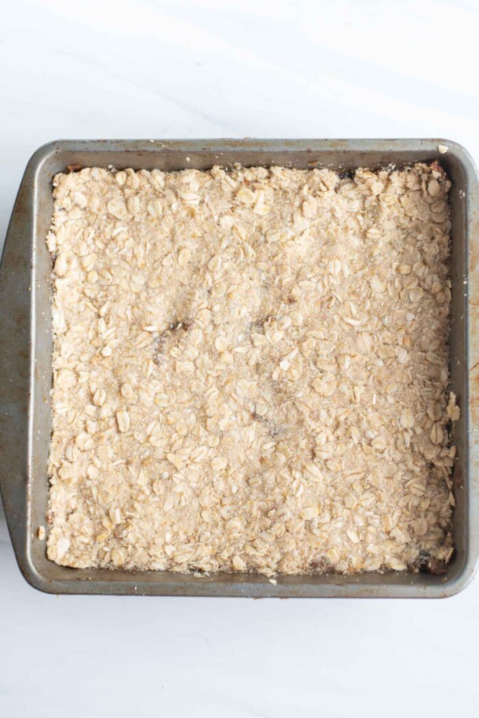Overhead image of a raw oat bar in baking pan.