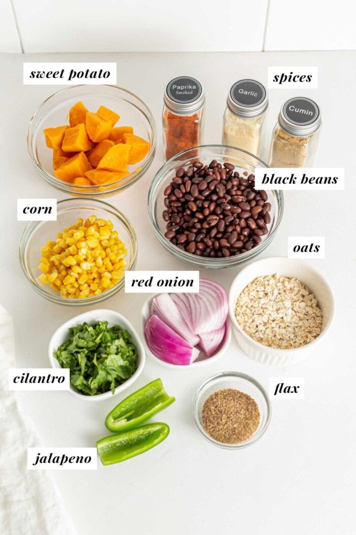 Various cooking ingredients in dishes on a counter.