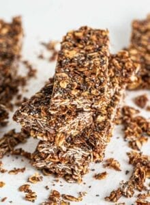 A stack of 3 chocolate chia energy bars with oats.