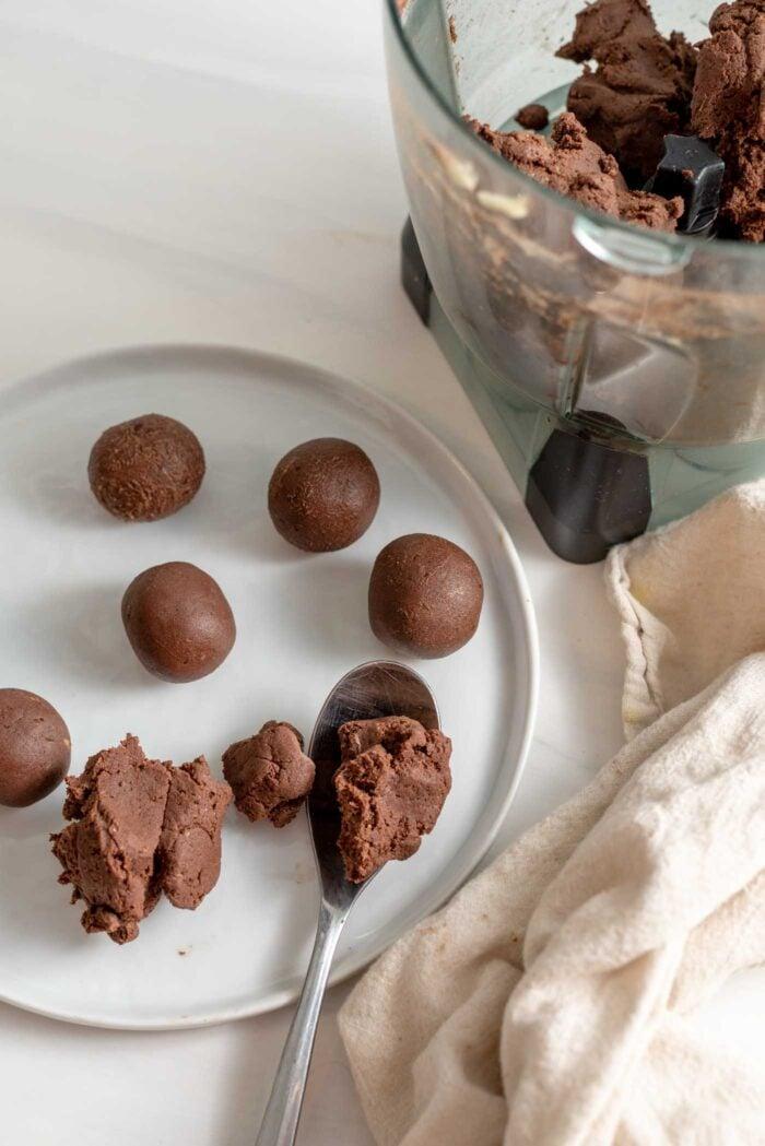 Rolling chocolate dough into balls.