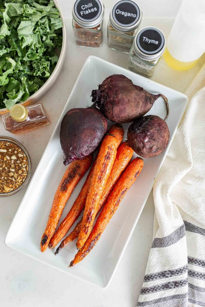 3 roasted beets and carrots on a serving platter.