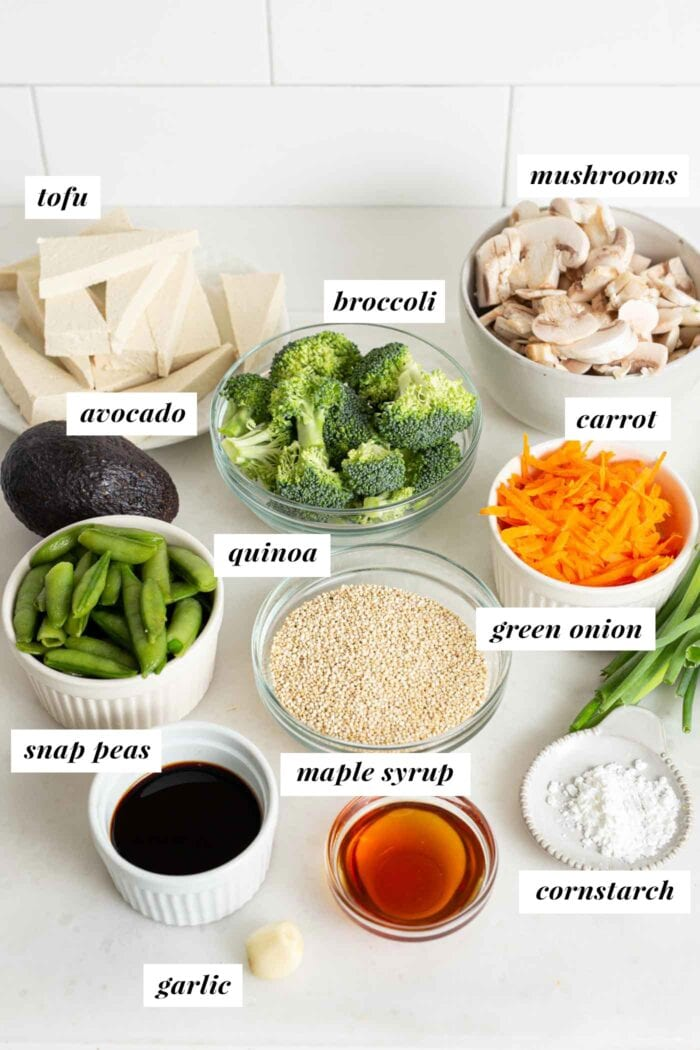 Labelled ingredients for making a teriyaki quinoa bowl.