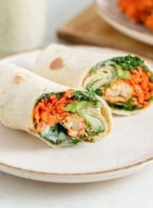Wrap with buffalo cauliflower and avocado in it, sliced in half to show inside.