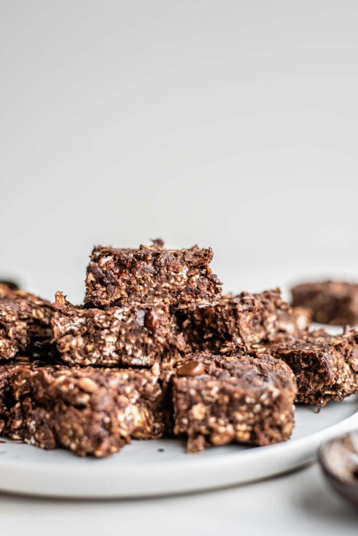 Front view of plate of chocolate oats bars with chocolate chips.