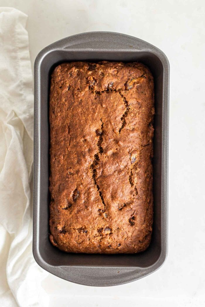Overhead image of a baked pumpkin loaf in a loaf pan.