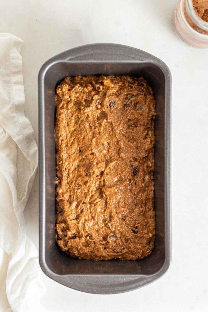 Raw pumpkin loaf batter in a loaf pan.