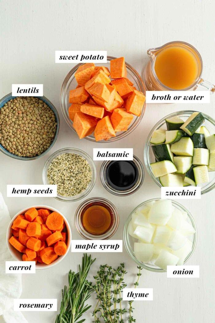 Labelled ingredients for making a roasted vegetable lentil salad.