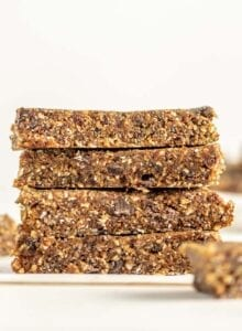 Front view of a stack of 4 energy bars on a folded piece of parchment paper.