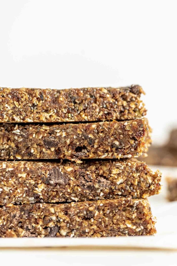 Close up side view of energy bars made with nuts, seeds and chocolate chips.