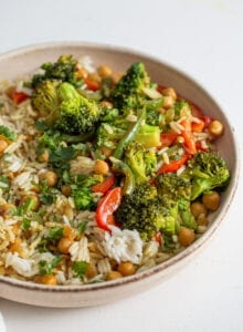 Bowl of rice, chickpeas and vegetables in a creamy curry sauce.