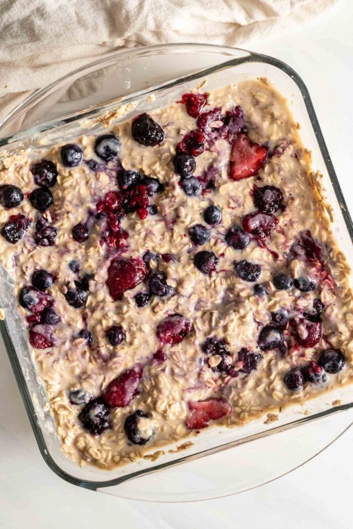 Overhead view of a baking dish of baked berry oatmeal bars.