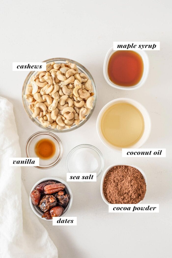 Overhead view of labelled ingredients for making cashew cookie dough bars.