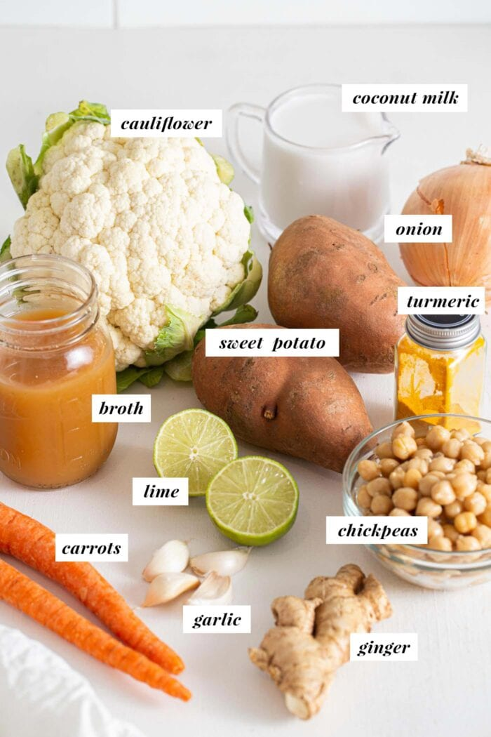 Labelled ingredients for making a sweet potato, cauliflower and carrot soup.