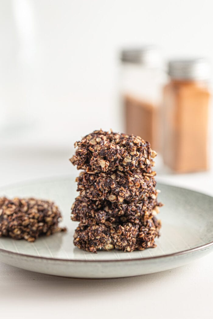 Stack of 4 chocolate no-bake oatmeal cookies on a small plate.